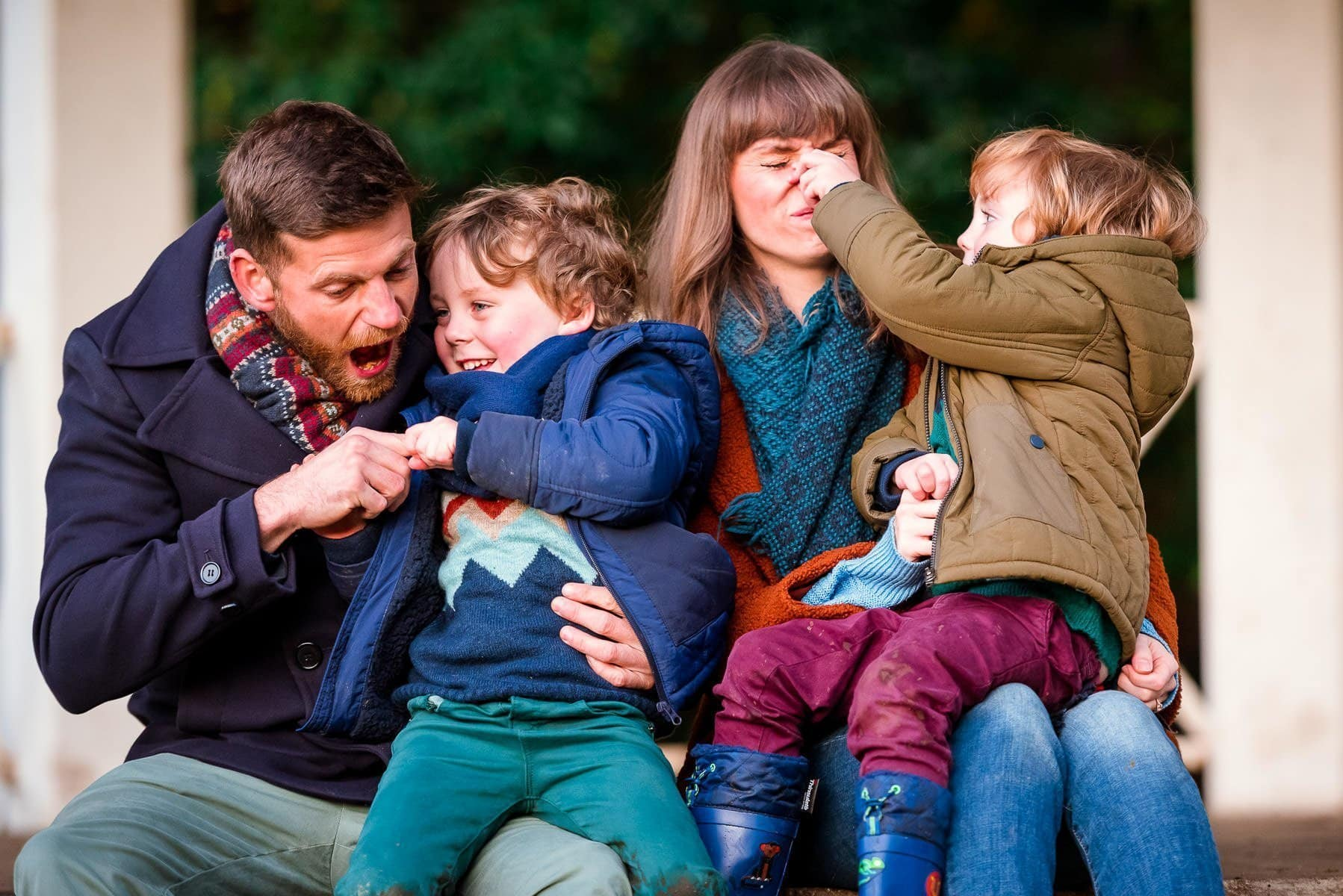 Children playing with their parents during their family photography session in Norwich