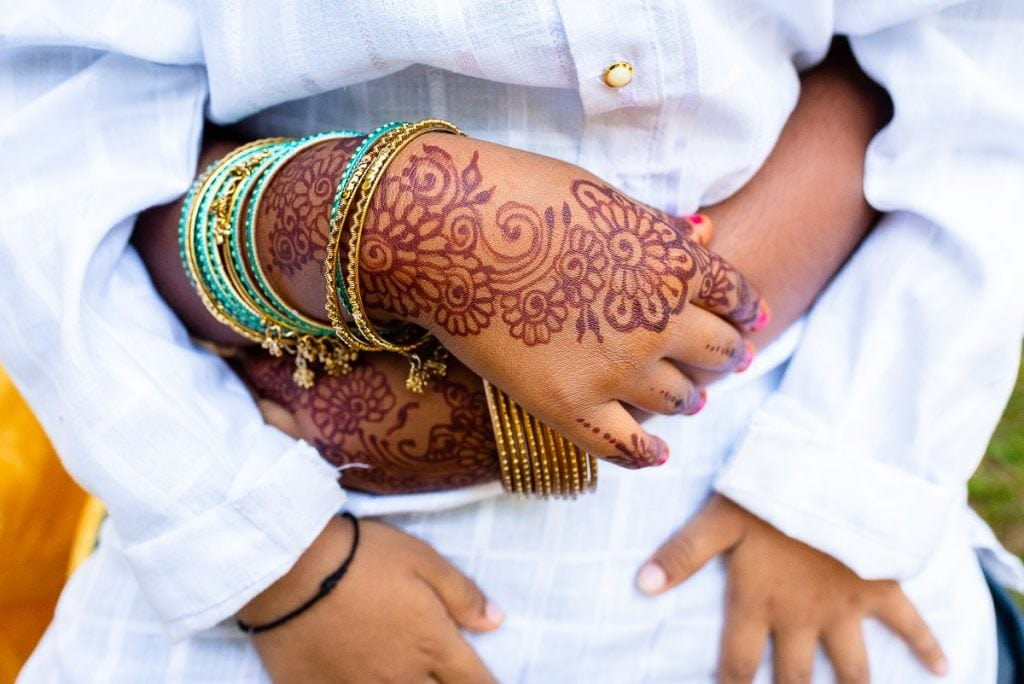 Mehndi art on a childs hands
