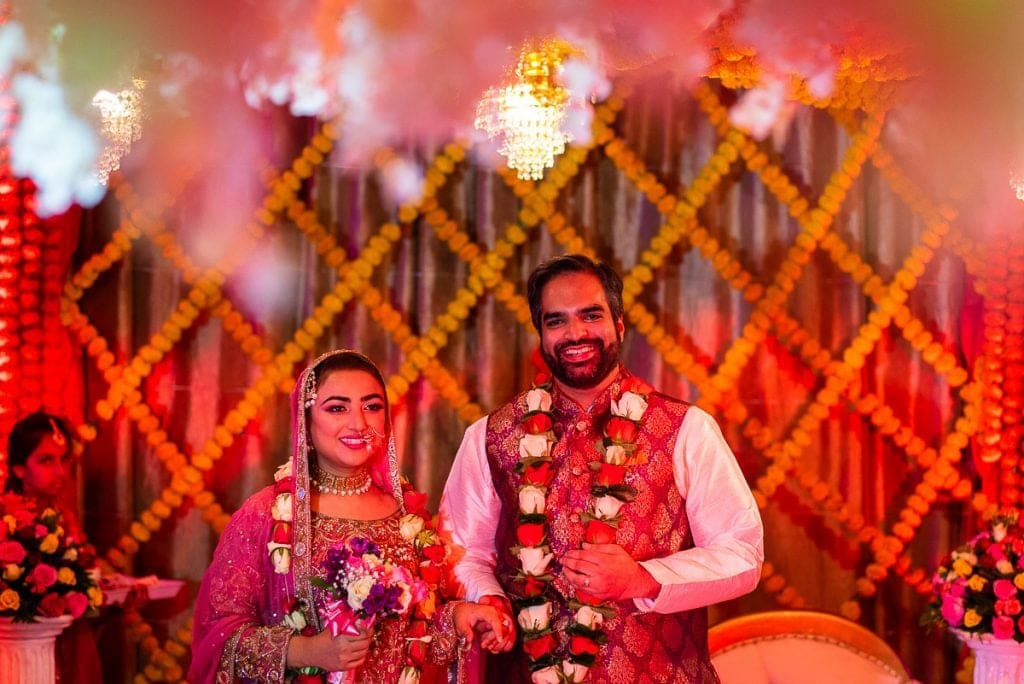Bride and groom at their Mehndi ceremony