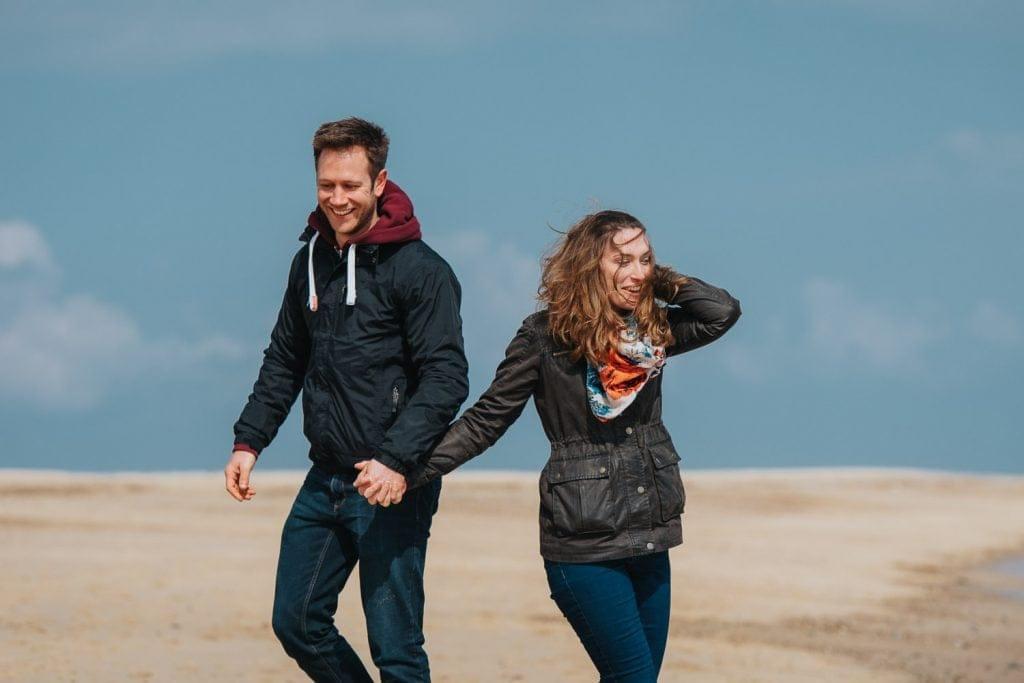 Couple in love photography session on Norfolk Beach