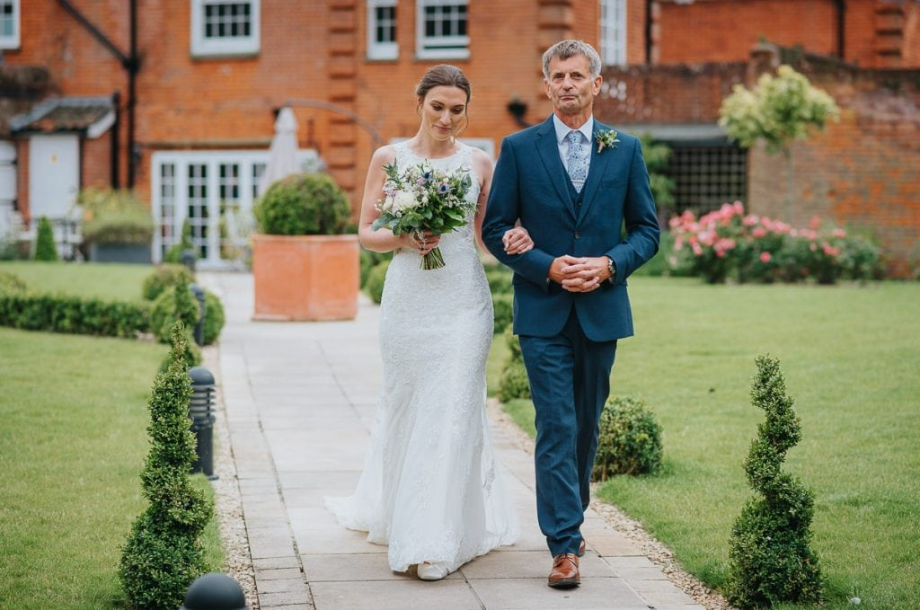 Bride and her father  walking to Garden Room for wedding at Norfolk Mead Hotel