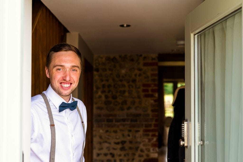 Smiling groom ready for his wedding at Manor Mews