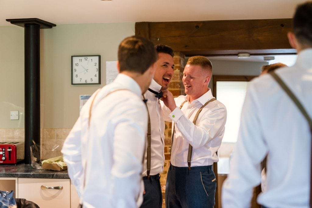 Funny moment during groom prep at Manor Mews wedding
