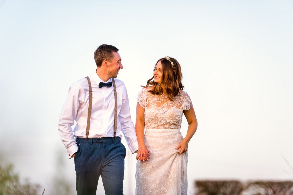 Newlywed couple portraits during sunset at Manor Mews