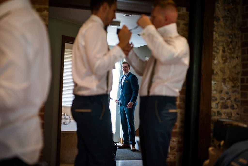 Best man arrives during groom prep at Manor Mews wedding