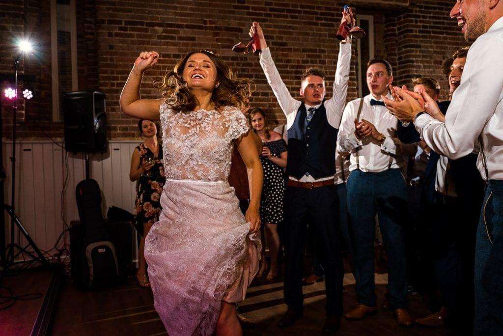 Bride dancing during wedding at Manor Mews