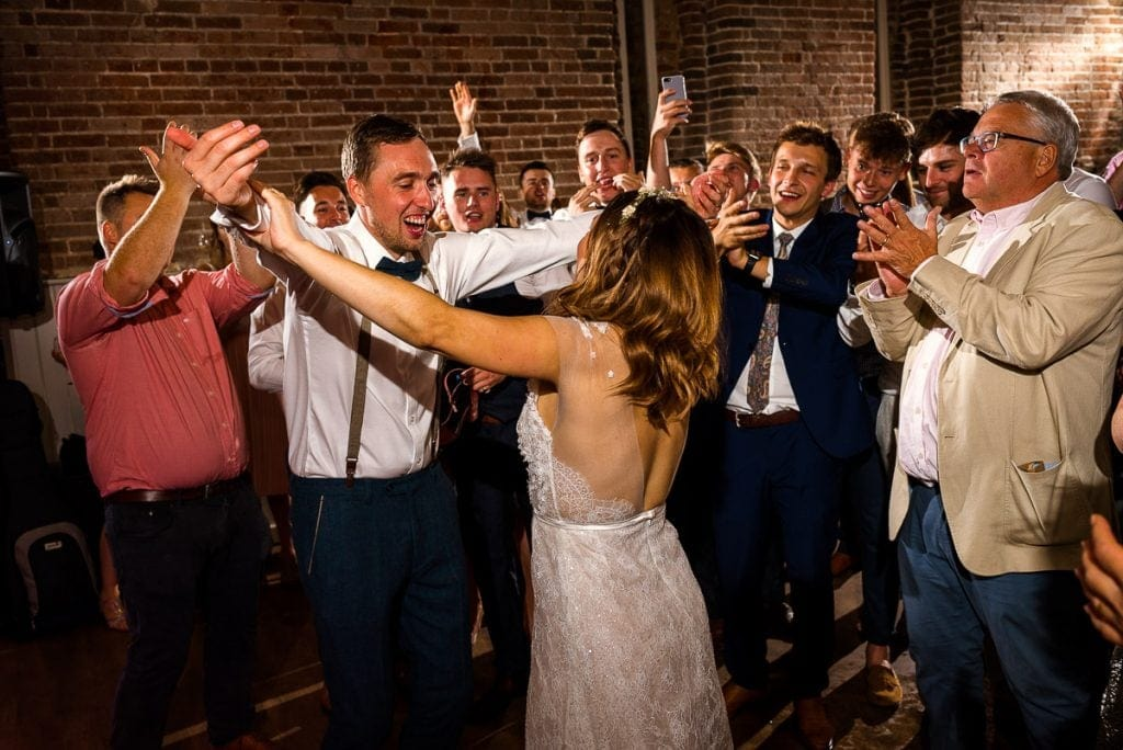 Bride and grom dancing during wedding at Manor Mews